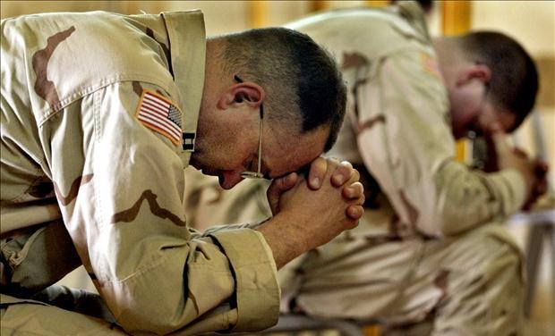 military men in prayer